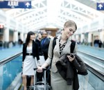 Airport Business Travel, Young Woman Checking Phone, Copy Space